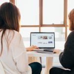 kobu-agency-685117-unsplash-two-ladies-using-mac-on-one-table
