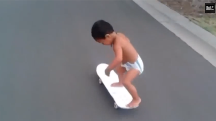 Skateboarding toddler