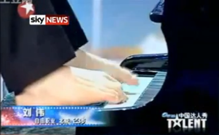 Playing the piano with his feet