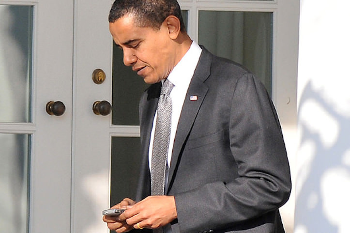 Obama using his blackberry