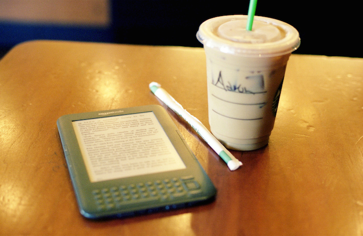 Reading kindle at starbucks