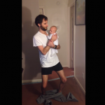 puttings-pants-on-holding-baby-1.png