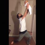 puttings-pants-on-holding-baby-8.png