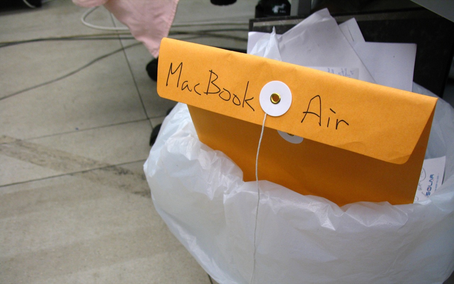 Macbook air in trash can