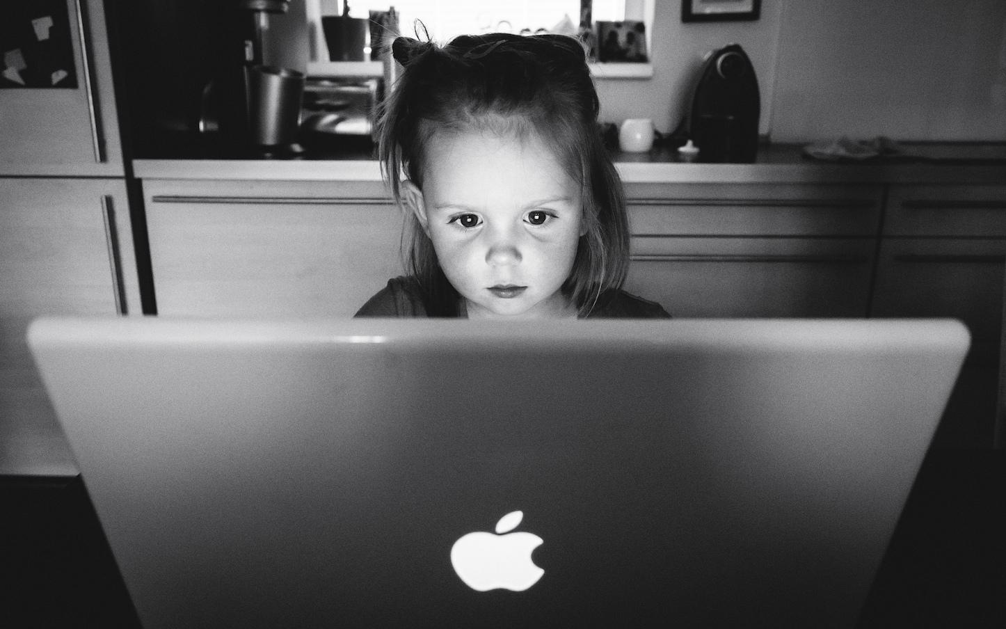 Little girl Using Mac