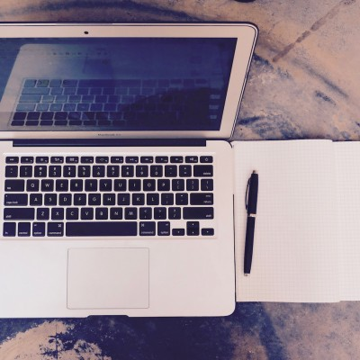 macbook-air-with-notebook-and-pen.jpg