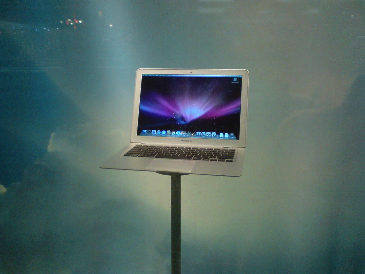 Macbook air old model standing on table