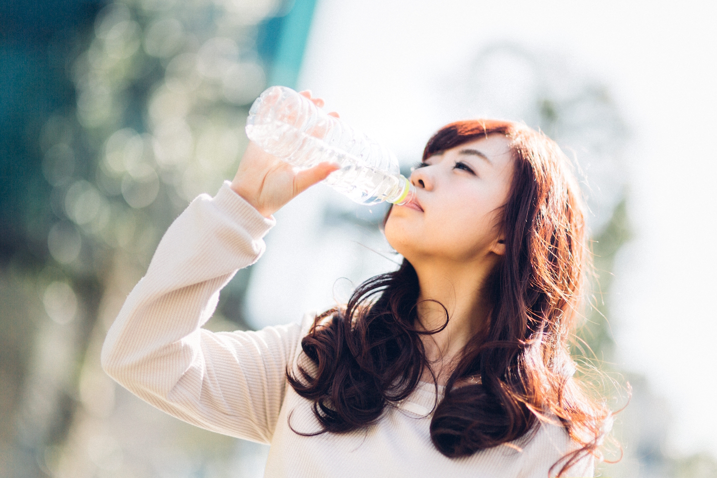 Yuka drinking water from bottle
