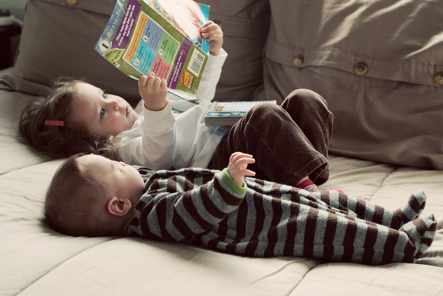 Little kids reading books is adorable