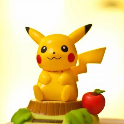 pikachu-sitting-on-top-of-a-tree-trunk.jpg