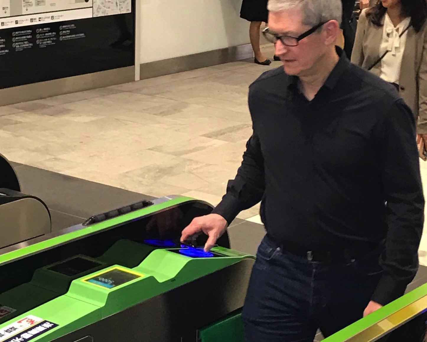 Tim Cook Passes Train Gate in Japan