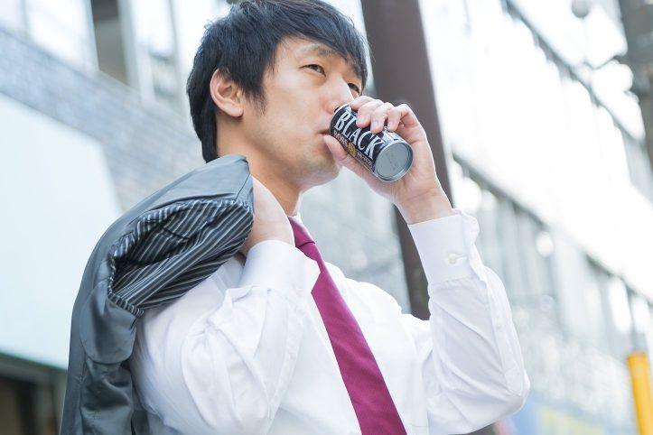 salary-man-with-can-coffee.jpg