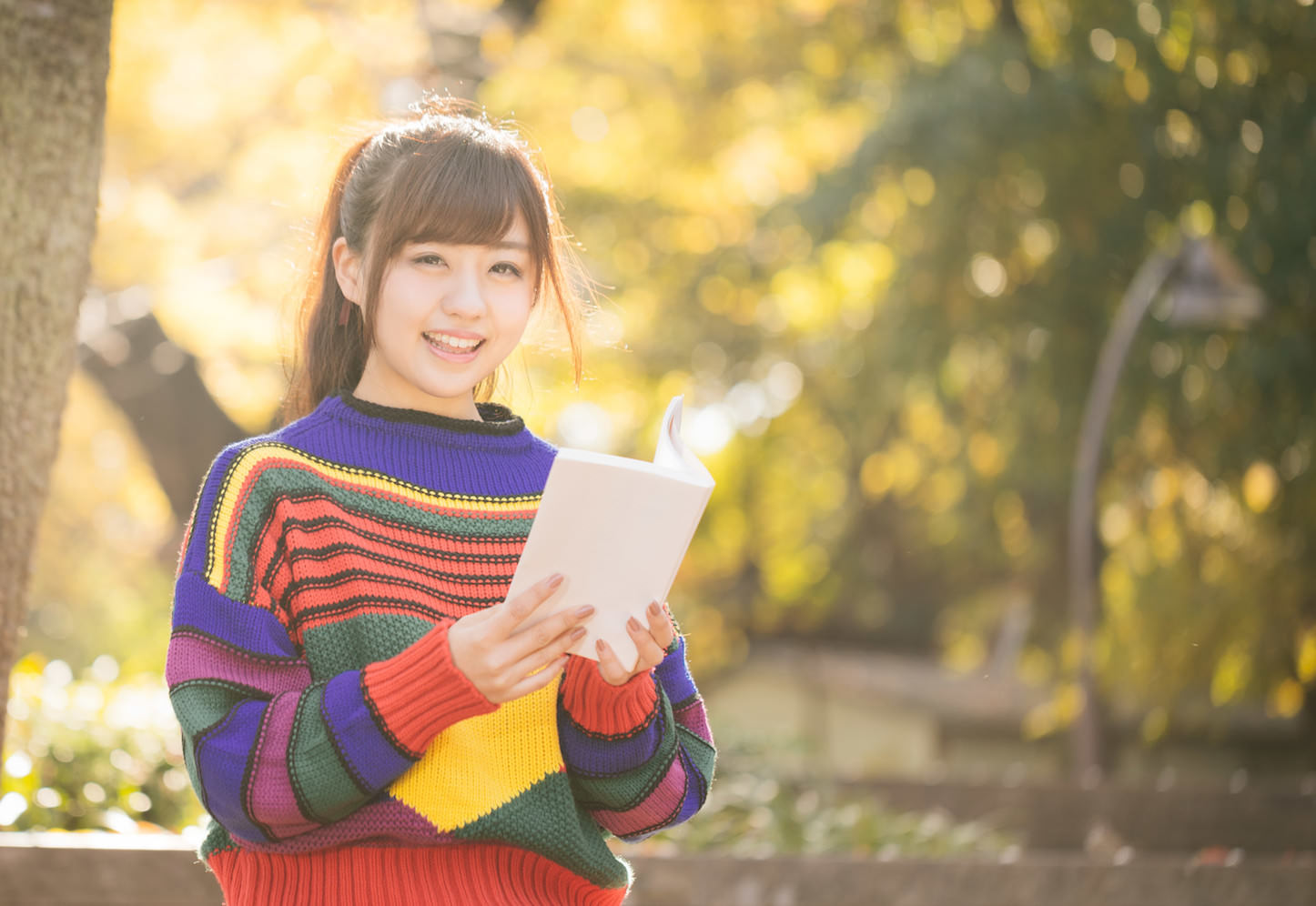 Yuka smiling and reading a book