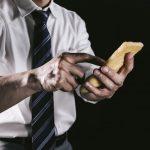 Man-Using-Abura-Age-iPhone-Pakutaso-02.jpg