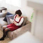 reading-book-on-sofa-pakutaso.jpg