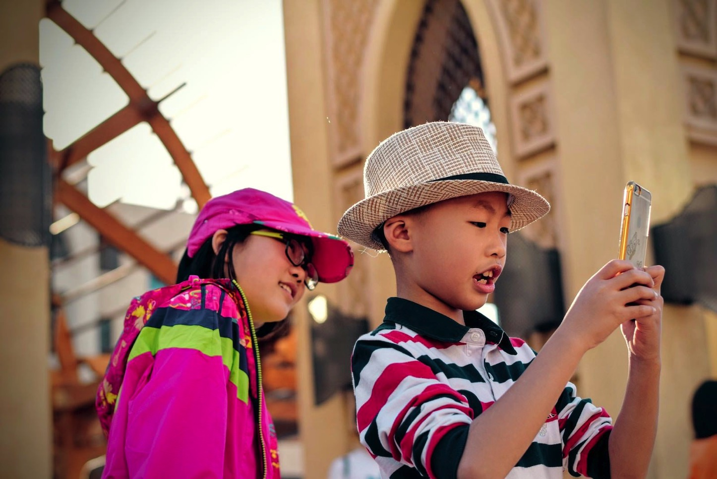 tim-gouw-75989-kids-using-iphone-unsplash.jpg