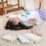 Yuka-is-bored-of-reading-pakutaso.jpg