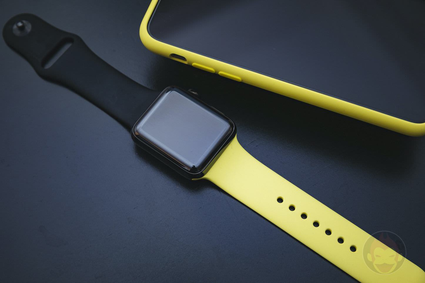 Apple Watch with iPhone in yellow