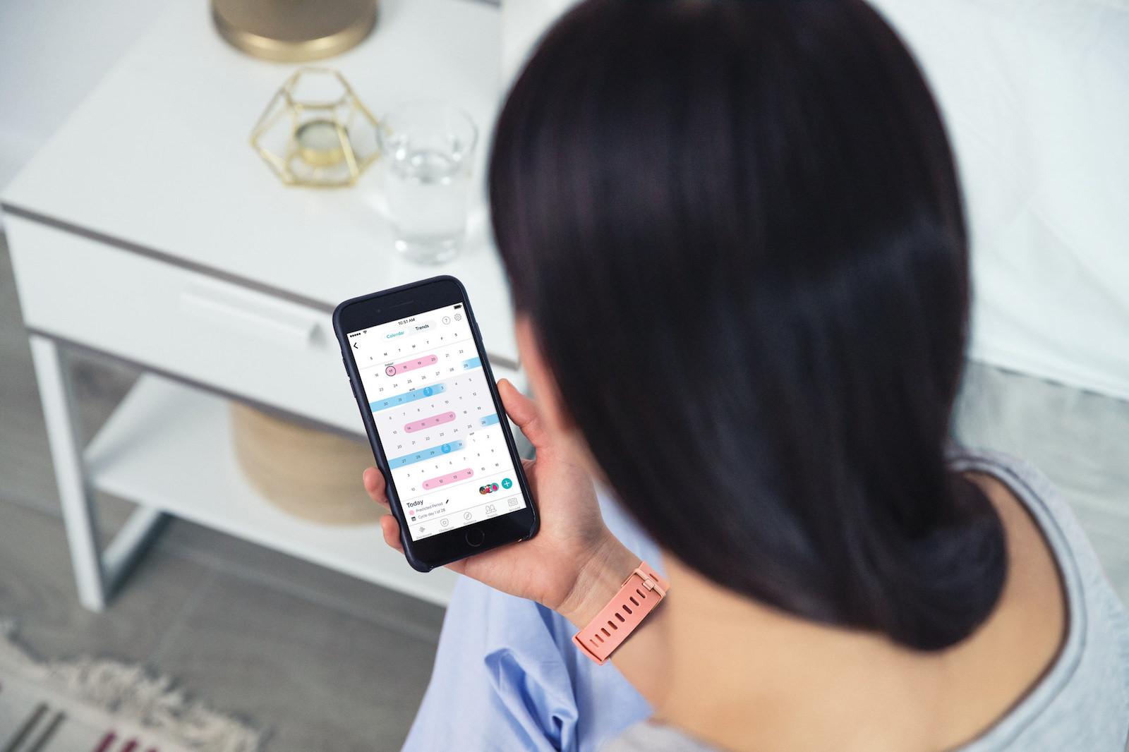 Fitbit Versa Lifestyle Core Peach Bedroom CheckPhone FemaleHealth