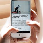 eddie-garcia-503684-unsplash-reading-news-on-iphone.jpg