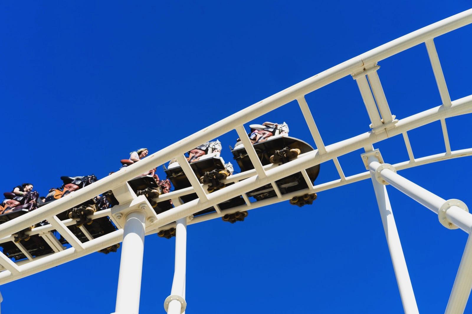 Dan gold 327082 unsplash roller coaster and blue sky
