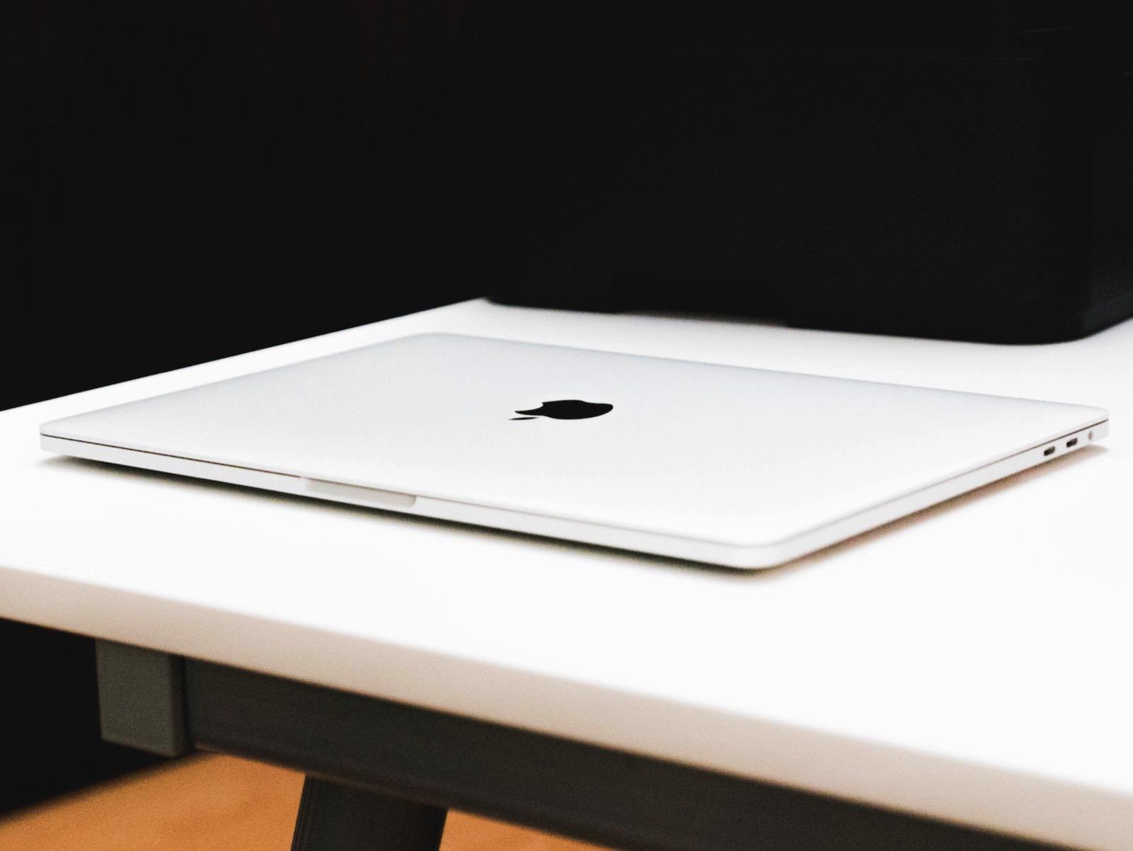 Iabzd 604210 unsplash macbook pro in white skin