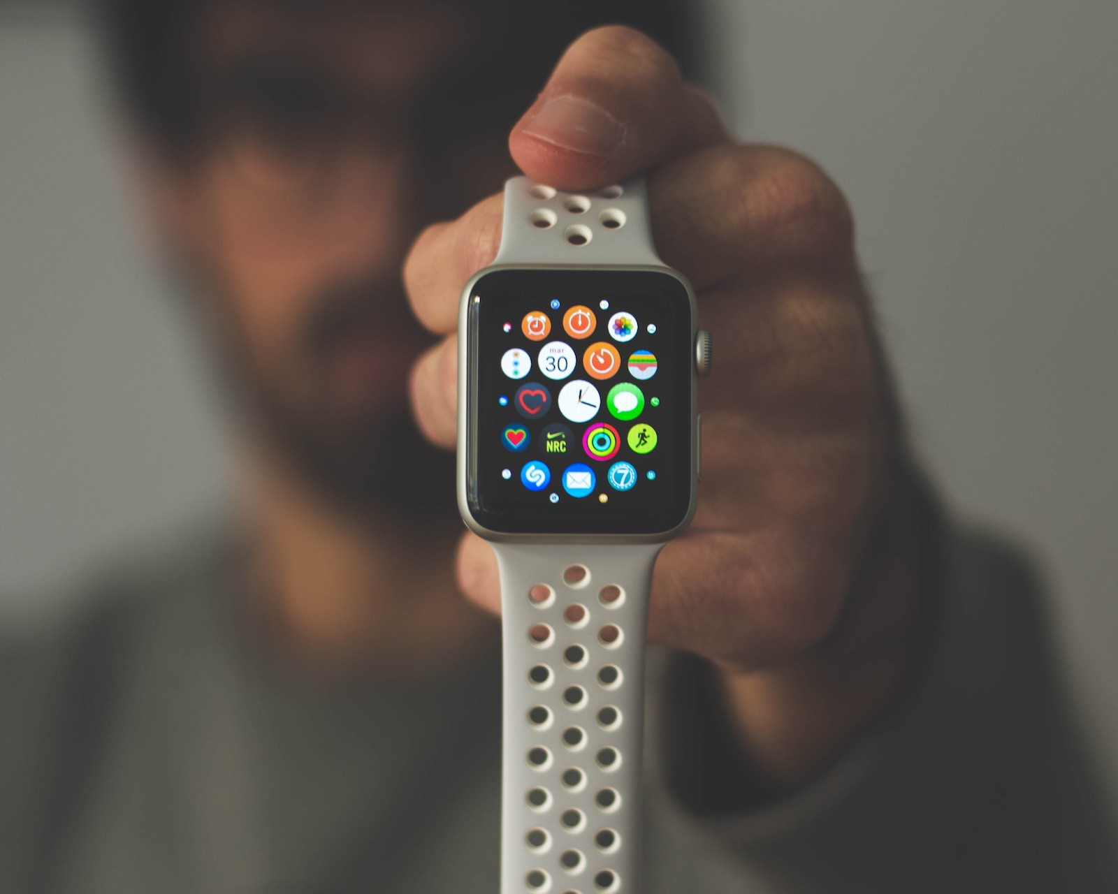 Daniel canibano 540359 unsplash holding an apple watch
