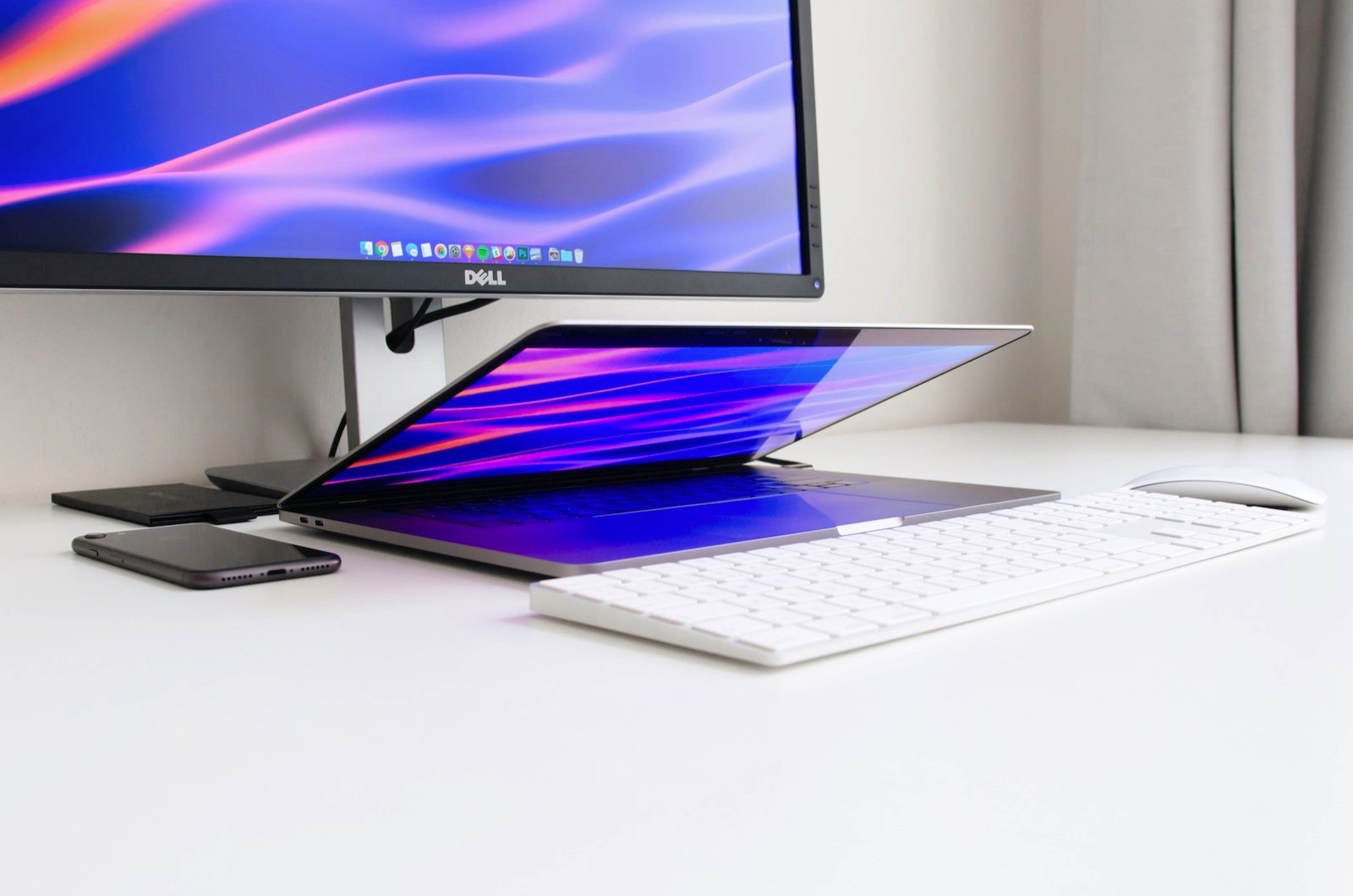 ales-nesetril-1070147-unsplash-using-macbookpro-with-monitor.jpg