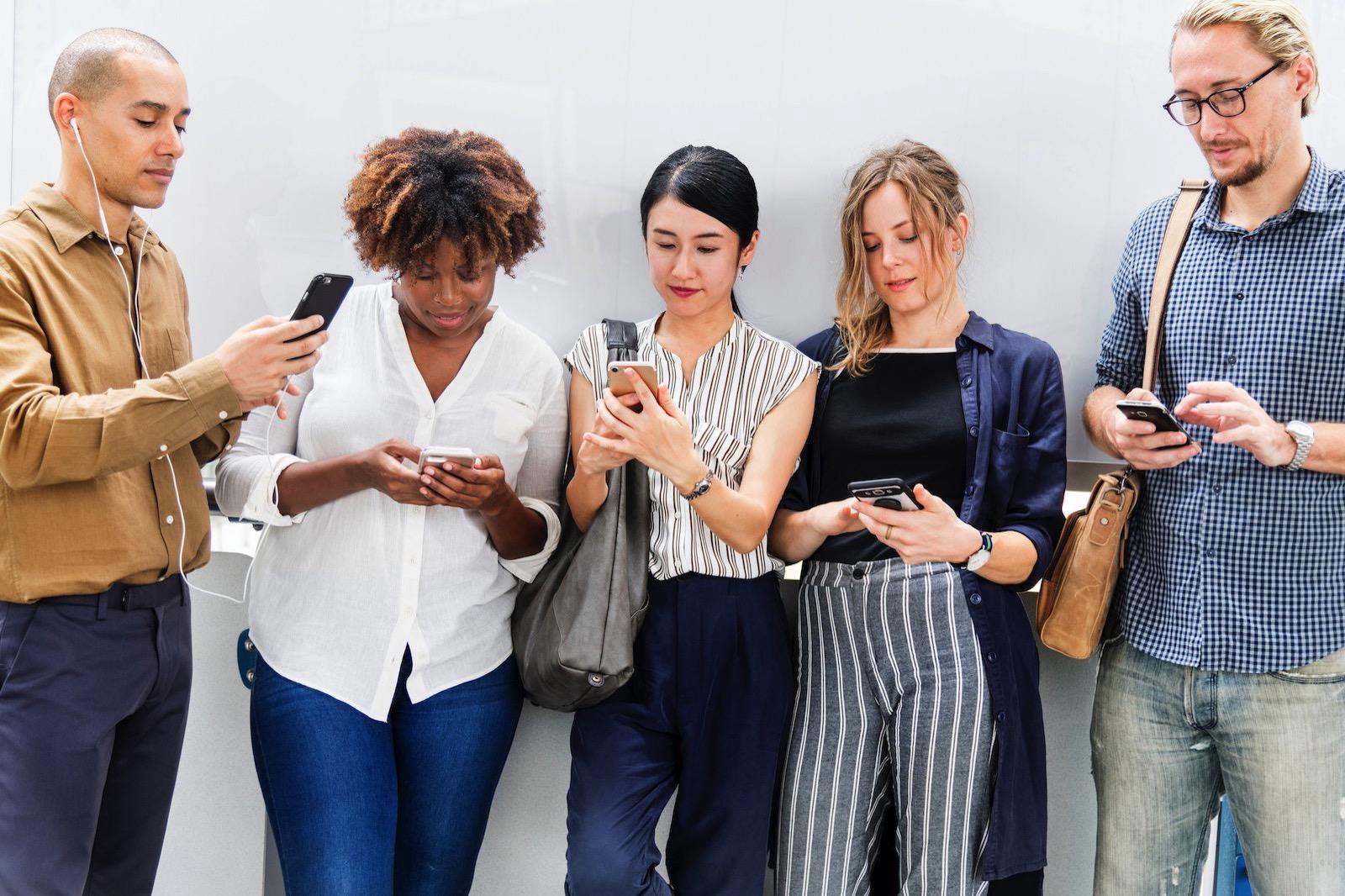 Rawpixel 1054575 unsplash people looking at phones