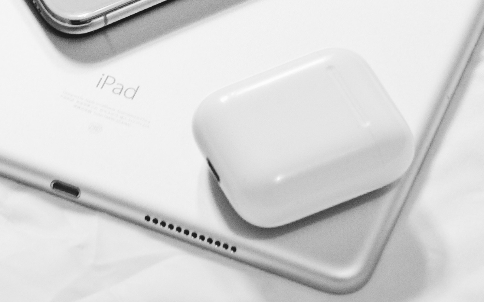 eleven-x-517447-unsplash-airpods-and-ipad-and-iphone.jpg