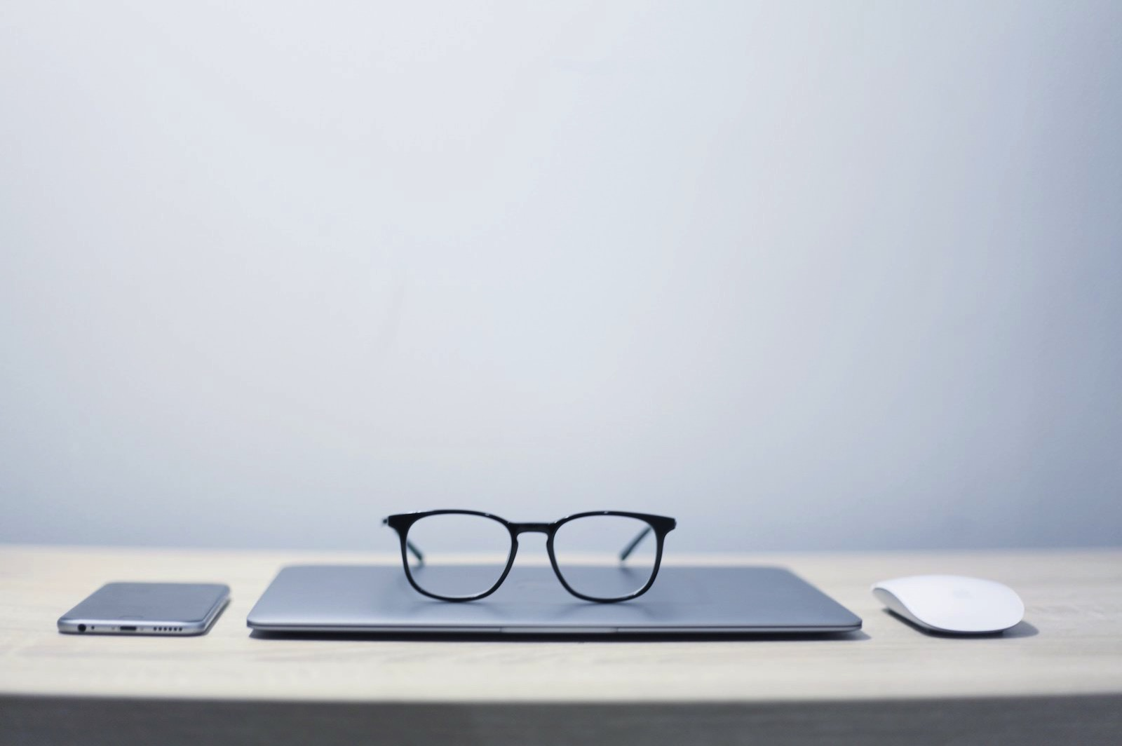 jesus-kiteque-wn-KYaHwcis-unsplash-glasses-on-apple-products.jpg